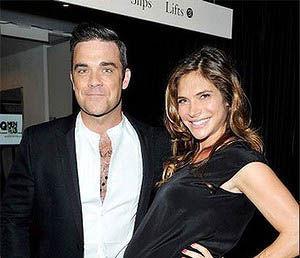 Robbie Williams a devenit tatic