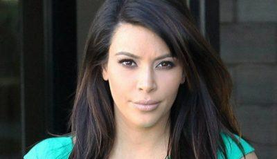 De ce Kim Kardashian nu zâmbește