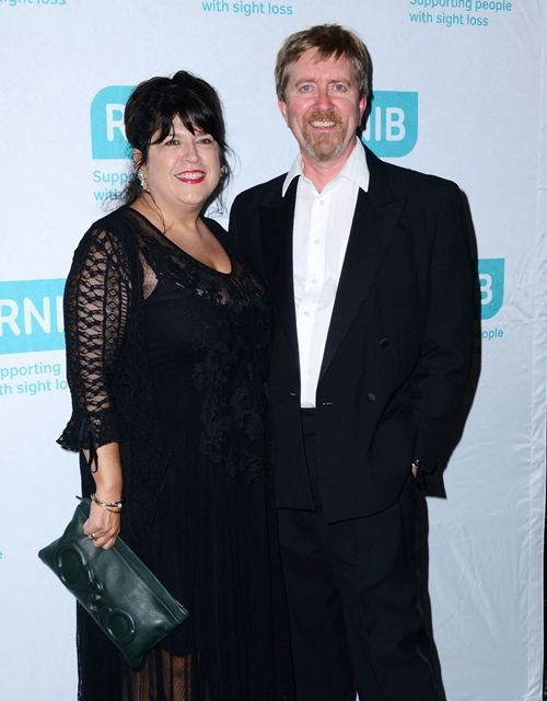 E. L. James, husband Niall Leonard attend the Royal National Institure Of Blind People Summer Gala at London Hilton