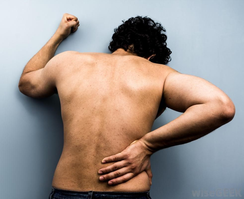 man-with-lower-back-pain-against-blue-background