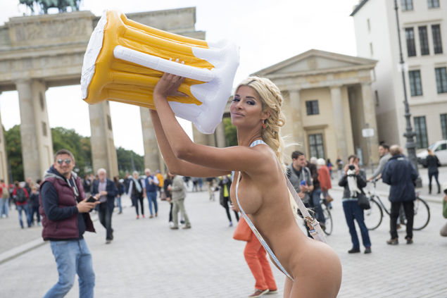 **WARNING, CONTAINS NUDITY** Micaela Schaefer poses almost naked infront of the Brandenburgergate in a Oktoberfest costume