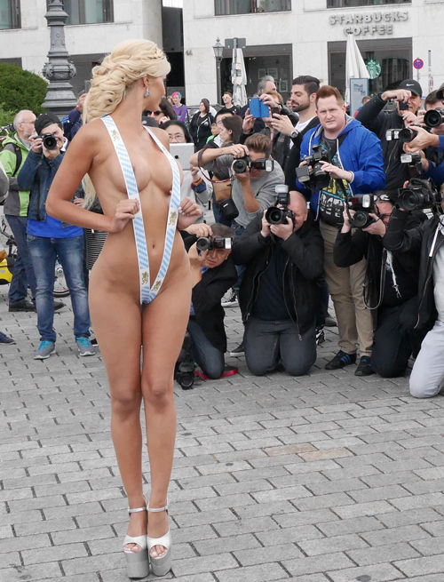 **WARNING, CONTAINS NUDITY** Micaela Schaefer poses almost naked infront of the Brandenburgergate in Berlin in a Oktoberfest costume