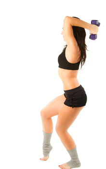 woman with  dumbbells workout in gym