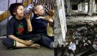 Scene şocante cu copiii străzii din Chişinău! Cerşesc, consumă alcool şi se droghează printre ruinele hotelului Naţional