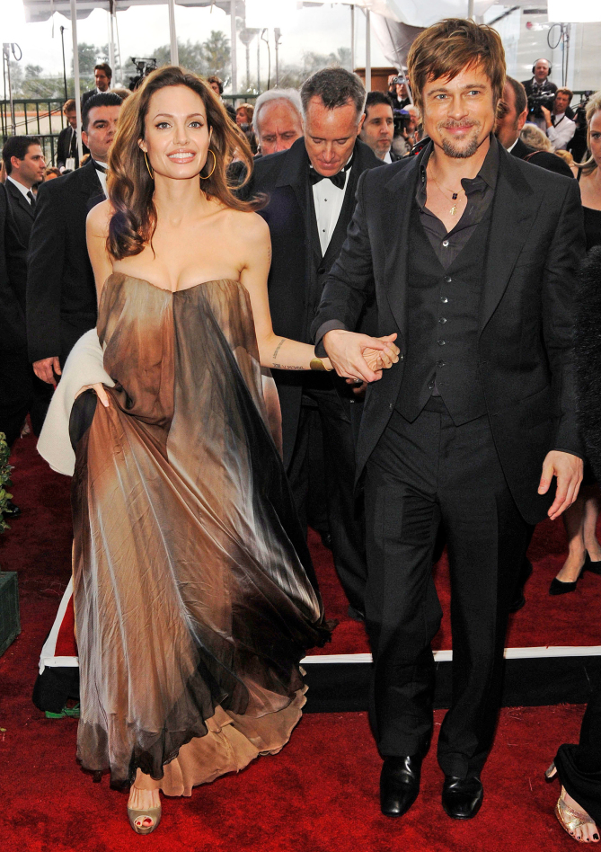 Actress Angelina Jolie and Actor Brad Pitt arrive to the TNT/TBS broadcast of the 14th Annual Screen Actors Guild Awards at the Shrine Auditorium on January 27, 2008 in Los Angeles, California. 15313_KM_1335.JPG TNT/TBS Broadcasts The 14th Annual Screen Actors Guild Awards - Red Carpet Shrine Auditorium Los Angeles, CA United States January 27, 2008 Photo by Kevin Mazur/WireImage.com To license this image (15354551), contact WireImage.com