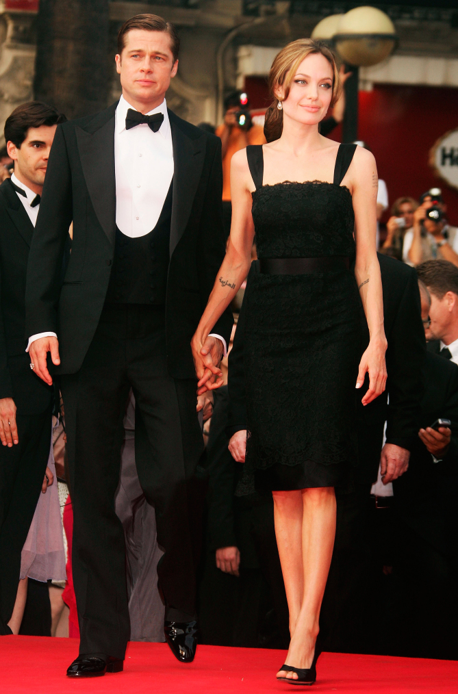 """CANNES, FRANCE - MAY 21:  Actors Brad Pitt and Angelina Jolie attend the premiere for the film """"A Mighty Heart"""" at the Palais des Festivals during the 60th International Cannes Film Festival on May 21, 2007 in Cannes, France.  (Photo by Pascal Le Segretain/Getty Images)"""