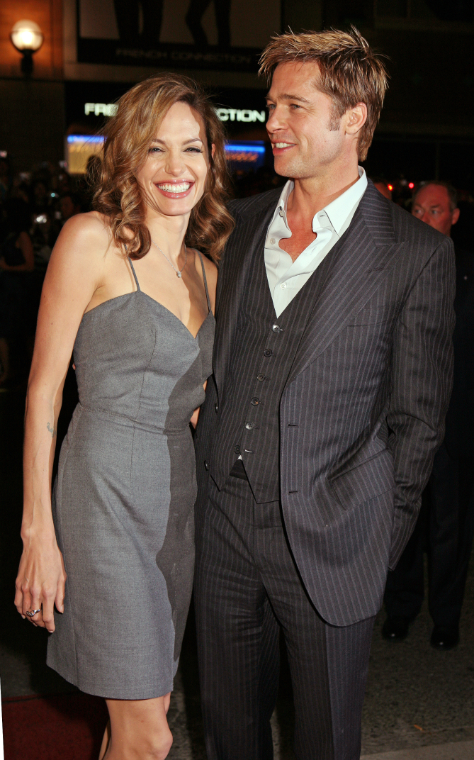 """194C46C2 08 Sep 2007, Toronto, Ontario, Canada --- Actors Brad Pitt and Angelina Jolie arrive at the North American premiere of Pitt's movie """"The Assassination of Jesse James by The Coward Robert Ford,"""" during the 2007 Toronto International Film Festival. --- Image by © Jorge Uzon/Corbis canada - 2007 toronto film festival - """"the assassination of jesse james"""" premiere  42-18891730  canada © corbis.  all rights reserved."""