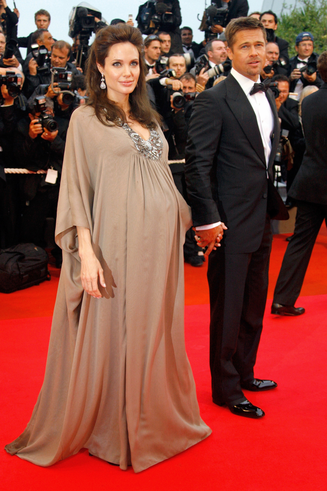 """American actors Angelina Jolie and Brad Pitt arrive for the premiere of the film """"Changeling"""" at the 61st International film festival in Cannes, southern France, on Tuesday, May 20, 2008.  (AP Photo/Evan Agostini)"""
