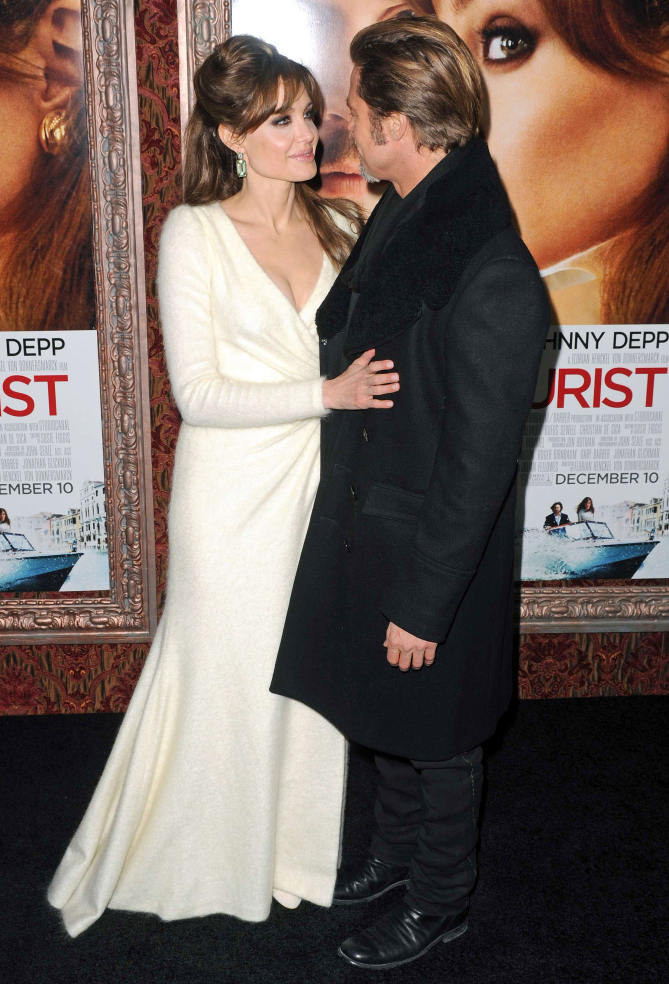6 December 2010 - New York , NY - Angelina Jolie and Brad Pitt at The Tourist World Premiere held at the Ziegfeld Theatre. Photo Credit: Brian Zak/Sipa Press/tourist_bz.006/1012070605