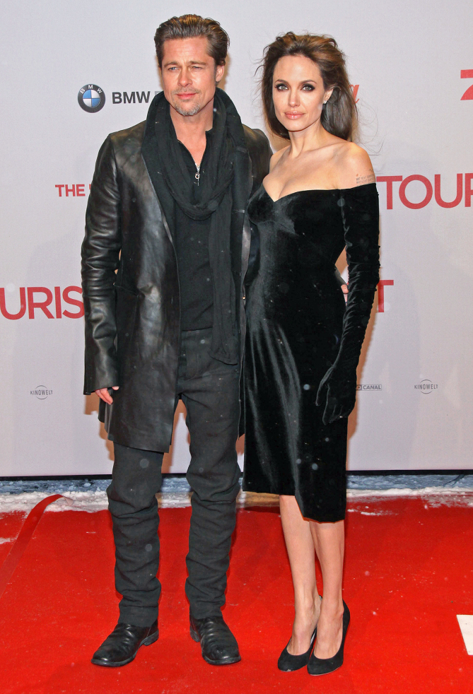 BERLIN, GERMANY - DECEMBER 14:  Actor Brad Pitt and actress Angelina Jolie attend the 'The Tourist' European premiere at CineStar on December 14, 2010 in Berlin, Germany.  (Photo by Anita Bugge/WireImage)