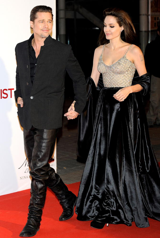 """MADRID, SPAIN - DECEMBER 16:  Brad Pitt and Angelina Jolie attend """"The Tourist premiere at Palacio de los Deportes on December 16, 2010 in Madrid, Spain.  (Photo by Carlos Alvarez/Getty Images)"""