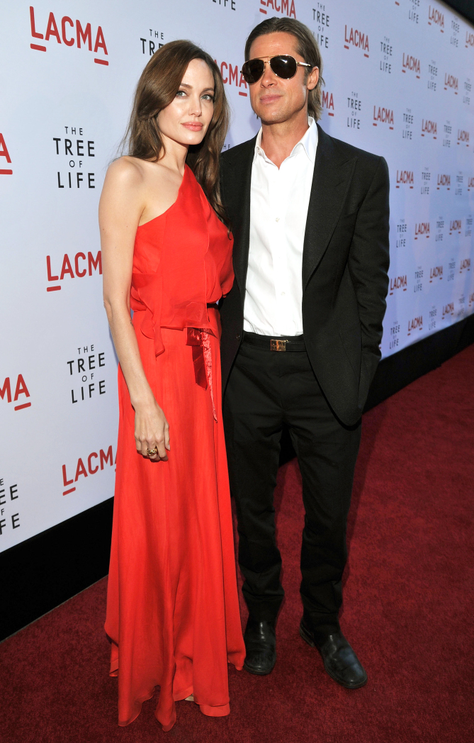 """LOS ANGELES, CA - MAY 24:  Actors Angelina Jolie and Brad Pitt arrive at """"The Tree Of Life"""" Los Angeles Premiere at Bing Theatre at the Los Angeles County Museum of Art on May 24, 2011 in Los Angeles, United States.  (Photo by Lester Cohen/WireImage)"""