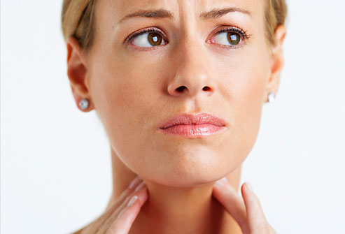 corbis_rf_photo_of_woman_with_sore_throat