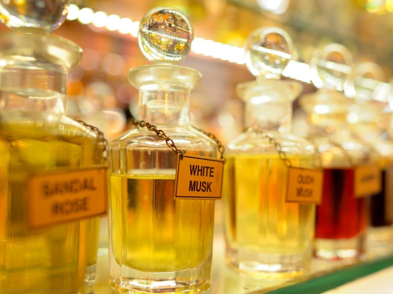 Various perfume bottles, for sale in a bazaar.