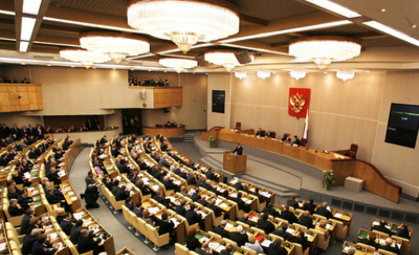 Russian Prime Minister Viktor Zubkov (R) delivers a speech during the first session of the newly elected deputies of the State Duma in Moscow, 24 December 2007. Russian Russian Prime Minister Viktor Zubkov hopes the new State Duma lower house of parliament will work in close contact with the government for solving social tasks, Itar-Tass news agency reported. AFP PHOTO / ALEXEY SAZONOV