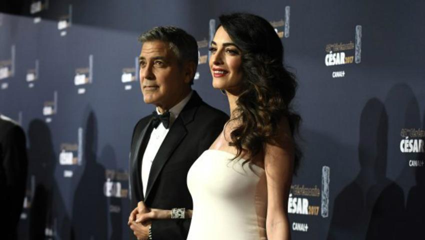 Foto: Amal Clooney, cu burtica proeminentă la gala Premiilor Cesar de la Paris!