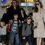 Brangelina and the kids, Maddox, Pax, Zahara, Shiloh, Vivienne and Knox, landed in Japan at Tokyo's Haneda International Airport. Hundreds of screaming fans waited for hours to catch a glimpse of the Hollywood stars and were delighted to see the whole family arrive. Brad is in Japan to promote his new film, 'Moneyball.'  Pictured: Brad Pitt, Angelina Jolie, Maddox Jolie-Pitt, Pax Jolie-Pitt, Zahara Jolie-Pitt, Shiloh Jolie-Pitt and Vivienne Jolie-Pitt  Ref: SPL320826  071111   Picture by: Scott Larson /  / Splash News  Splash News and Pictures Los Angeles:	310-821-2666 New York:	212-619-2666 London:	870-934-2666 photodesk@splashnews.com