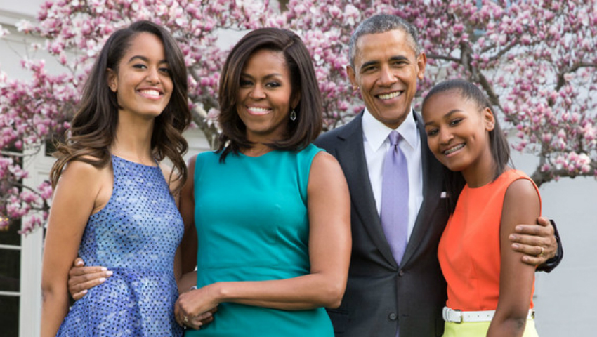 President Barack Obama, First Lady Michelle Obama, and daughters Malia and Sasha pose for a family portrait with Bo and Sunny in the Rose Garden of the White House on Easter Sunday, April 5, 2015. (Official White House Photo by Pete Souza)