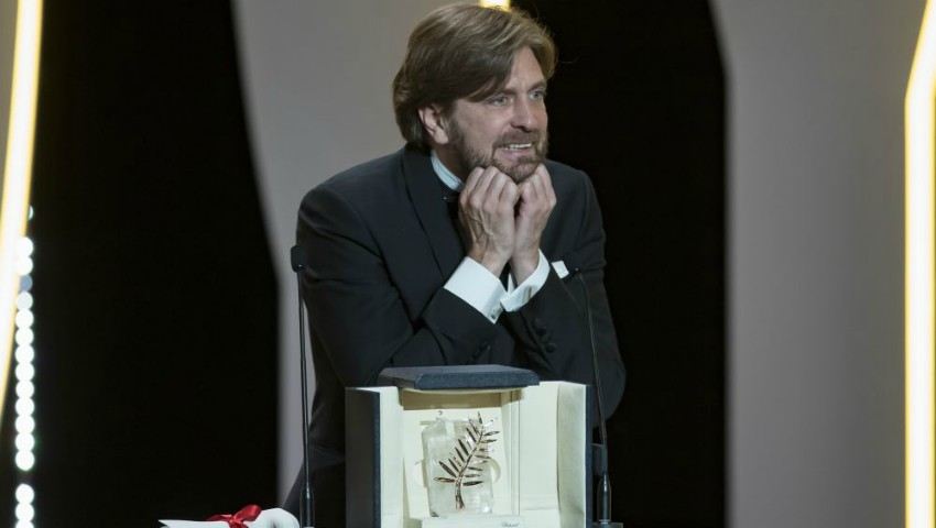 epa05996205 Swedish director Ruben Ostlund reacts after winning the Palme d'Or (Golden Palm) award for the movie 'The Square' during the Closing Awards Ceremony of the 70th Cannes Film Festival, in Cannes, France, 28 May 2017. The Golden Palm winning movie will be screened after the closing ceremony.  EPA/IAN LANGSDON