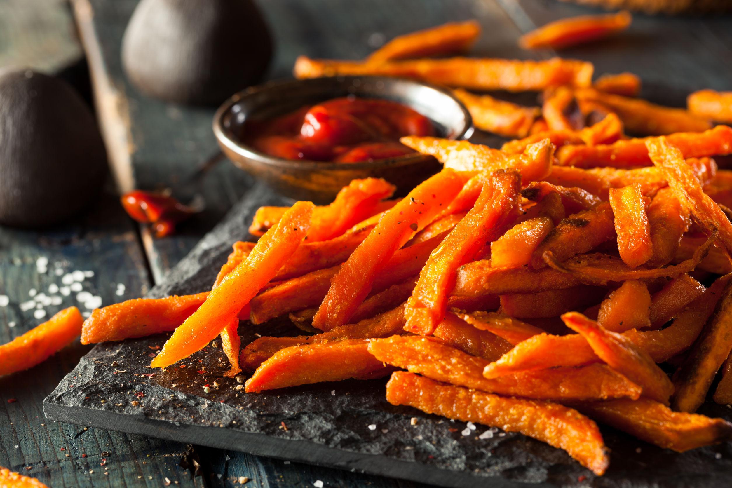 41012043 - homemade orange sweet potato fries with salt and pepper