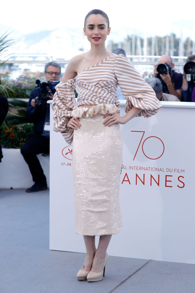 "CANNES, FRANCE - MAY 19: Actress Lily Collins attends the ""Okja"" photocall during the 70th annual Cannes Film Festival at Palais des Festivals on May 19, 2017 in Cannes, France. (Photo by Andreas Rentz/Getty Images)"