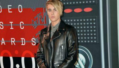 Justin Bieber a lovit cu mașina un paparazzo