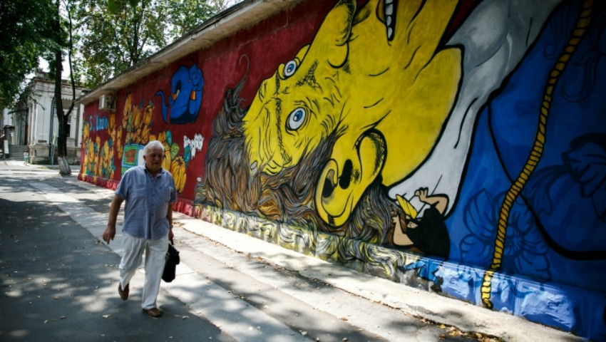Un tânăr artist a creat o pictură murală impresionantă în centrul Capitalei