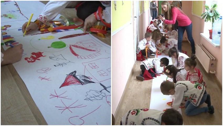 Foto: Desen demn de cartea recordurilor! Copiii de la grădinița nr. 225 din Capitală au desenat toamna pe 1 km de hârtie