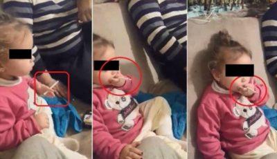 Imagini video revoltătoare! O fetiță de doar doi anișori este încurajată să fumeze și să bea cafea