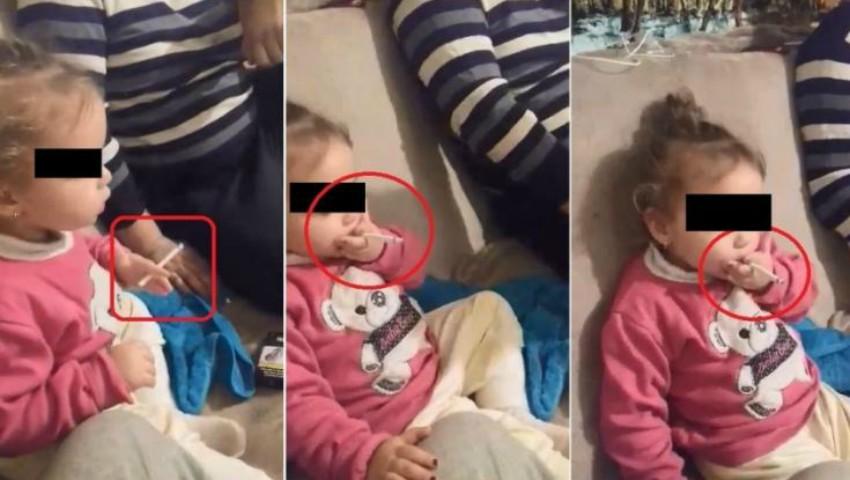 Foto: Imagini video revoltătoare! O fetiță de doar doi anișori este încurajată să fumeze și să bea cafea