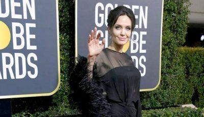 Cine a fost partenerul Angelinei Jolie la Globurile de aur 2018