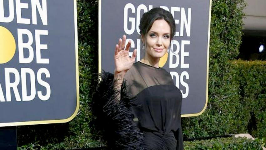 Foto: Cine a fost partenerul Angelinei Jolie la Globurile de aur 2018