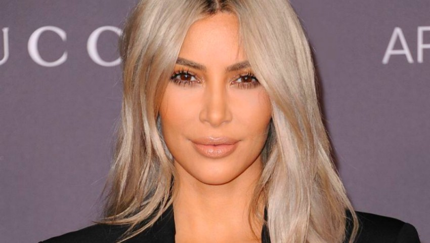 Foto: Prima imagine cu cel de-al treilea copil al lui Kim Kardashian