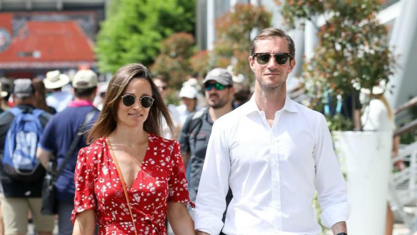 Foto: Pippa Middleton, surprinsă cu burtica de gravidă alături de soțul ei. Foto!