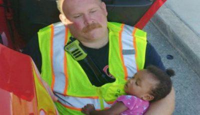 Povestea din spatele imaginii cu pompierul care ține un copil în brațe, după un accident