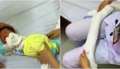 Video! Cum poți adormi un bebeluș cu ajutorul unui prosop obișnuit. Ideea ingenioasă a unei asistente medicale