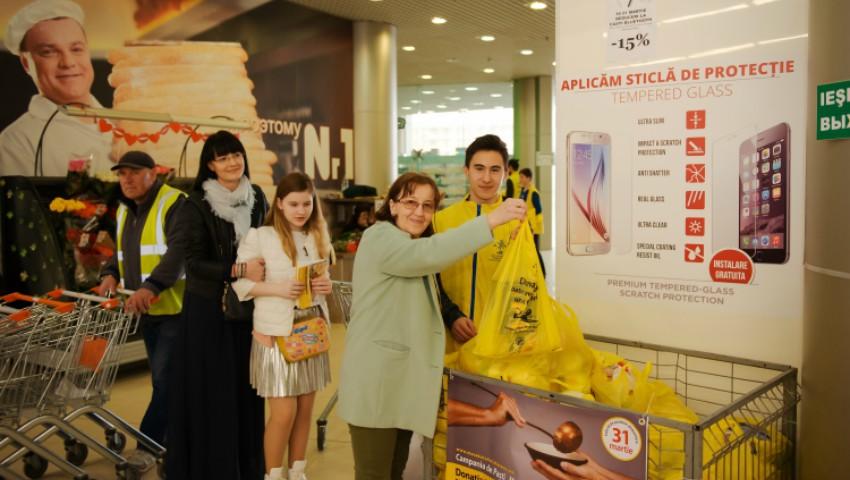 """Foto: Campania de Paşti """"Masa Bucuriei"""" a fost lansată – donează produse alimentare pentru bătrânii rămași singuri, în unul din magazinele implicate în actul de caritate!"""