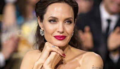 Angelina Jolie și-a acoperit spatele cu un tatuaj imens