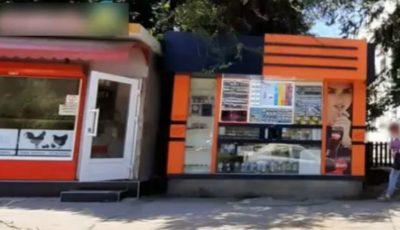 Doi minori cu cagule pe cap au atacat vânzătoarea unui ghișeu din Capitală și au furat toți banii