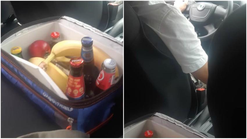 Băuturi răcoritoare, fructe, ciocolate sunt servite clienților, într-o mașină de taxi din capitală
