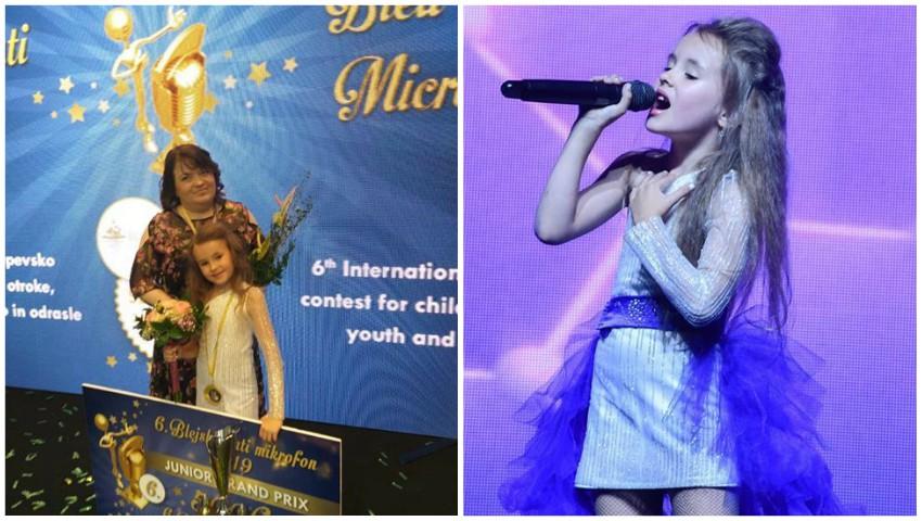 """Foto: Evelina Rusu, o fetiță de 7 ani din Moldova, a devenit câștigătoarea prestigiosului Festival ,,Bled Golden Microphone"""" din Slovenia!"""