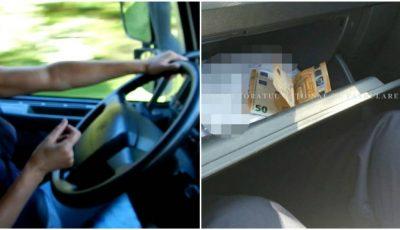 O șoferiță a aruncat în mașina poliției 100 de euro. A încercat să mituiască inspectorii de patrulare