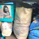 Foto: Scutece, hăinuțe și accesorii pentru gemenii din Măcărești, care au rămas fără mamă