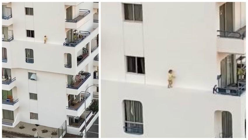 Foto: Scenă șocantă. O fetiță iese pe fereastră, apoi merge pe bordura îngustă a fațadei blocului