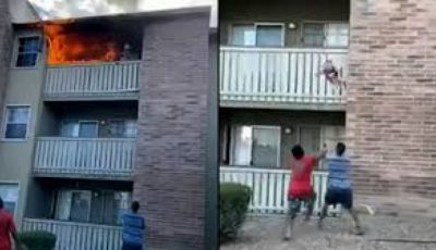 Video viral. Momentul în care un copil, aruncat de la balconul unui apartament în flăcări, este salvat
