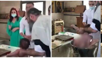 O mamă, șocată în timpul botezului după ce bebelușul este aproape scăpat în cristelniţă