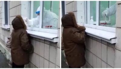 O femeie din municipiul Chișinău, testată pentru Covid-19, afară, în ploaie