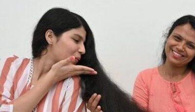 Tânăra cu cel mai lung păr din lume s-a tuns pentru prima dată în 12 ani