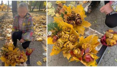 O fetiță confecționează buchete de toamnă, pe care le vinde în stradă, lângă un magazin
